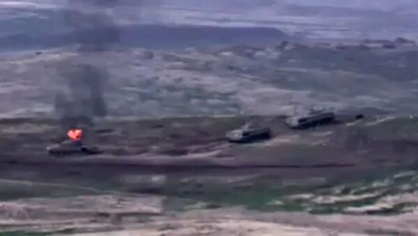 In this handout video grab released by the Armenian Defense Ministry, Armenian forces destroy Azerbaijani military vehicle at the contact line in Nagorno-Karabakh. - Sputnik International