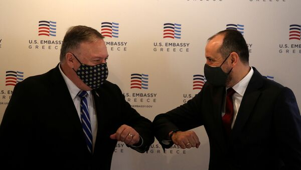 U.S. Secretary of State Mike Pompeo and North Macedonia's Deputy Prime Minister for Economy Fatmir Bytyqi touch elbows before a meeting with the Federation of Northern Greek Industries in Thessaloniki, Greece, September 28, 2020 - Sputnik International