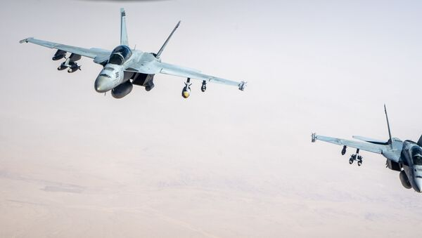 Two U.S. Navy F/A-18F Super Hornets assigned to Carrier Air Wing 17, deployed aboard the aircraft carrier USS Nimitz (CVN 68), fly over the U.S. Central Command area of responsibility Sept. 23, 2020. The F/A-18 Super Hornet is designed to perform fighter escort, fleet air defense, suppression of enemy air defenses, air interdiction, close air support, and aerial reconnaissance.  - Sputnik International