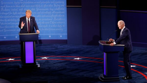 U.S. President Donald Trump and Democratic presidential nominee Joe Biden participate in their first 2020 presidential campaign debate held on the campus of the Cleveland Clinic at Case Western Reserve University in Cleveland, Ohio, U.S., September 29, 2020. - Sputnik International
