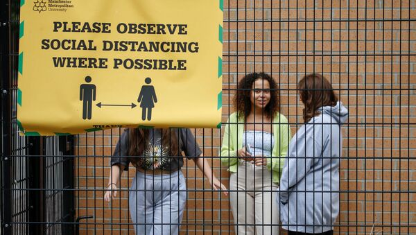 Students who are self-isolating stand in the grounds of their student accommodation, following the outbreak of the coronavirus disease (COVID-19) in Manchester, Britain, September 28, 2020 - Sputnik International