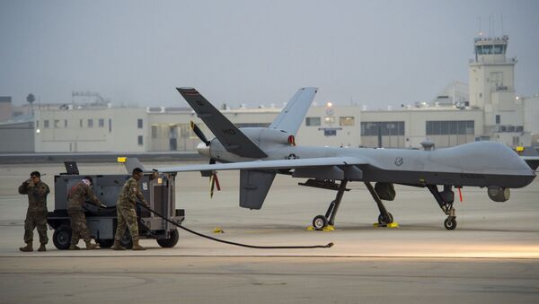 Senior Airman Jorge Garcia, 9th Aircraft Maintenance Unit assistant dedicated crew chief; Staff Sgt. Joseph Figueroa, 29th AMU avionics expeditor and 1st Lt. Ken Steamer, 29th AMU assistant officer in charge, help launch an MQ-9 Reaper during Exercise Agile Reaper, Sept. 15, 2020, at Naval Air Station Point Mugu, California. This routine training exercise enhances participants' MQ-9 skill sets and allows them to build the maritime domain picture with joint partners. - Sputnik International