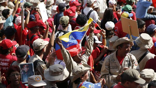 A supporter of Venezuela's President Nicolas Maduro shouts his support for him outside Miraflores presidential palace in Caracas, Venezuela, Monday, May 20, 2109. - Sputnik International