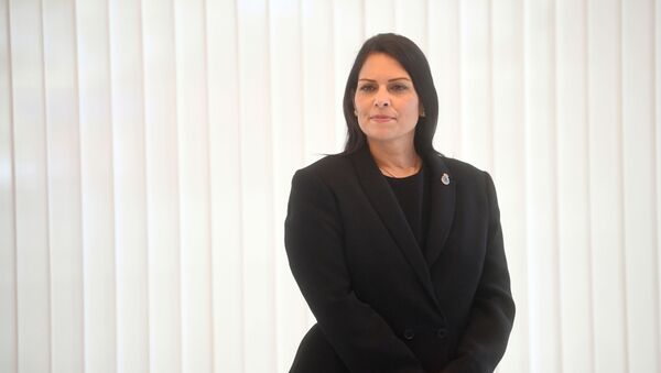 Britain's Home Secretary Priti Patel looks on ahead of a minute's silence inside the atrium at Scotland Yard in London on September 25, 2020, following the shooting of a British police officer by a 23-year-old man being detained at the centre. - Sputnik International
