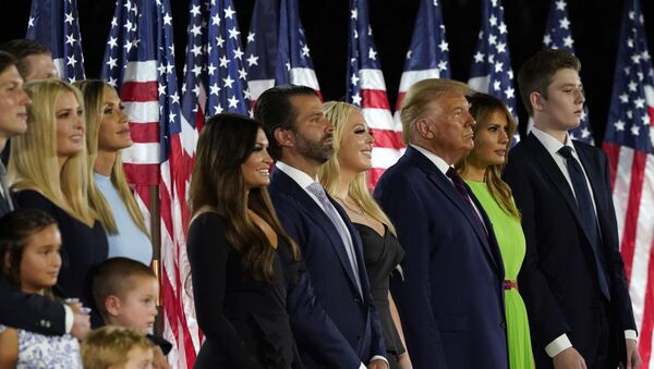 From left, Jared Kushner and his wife Ivanka Trump, Eric and Lara Trump, Kimberly Guilfoyle and Donald Trump Jr., Tiffany Trump, President Donald Trump and first lady Melania Trump and Barron Trump stand on stage on the South Lawn of the White House on the fourth day of the Republican National Convention, Thursday, Aug. 27, 2020, in Washington - Sputnik International