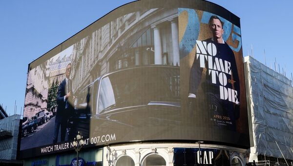 A film trailer for the 25th instalment in the James Bond series entitled No Time to Die is displayed at Piccadilly Circus in London, December 4, 2019. - Sputnik International
