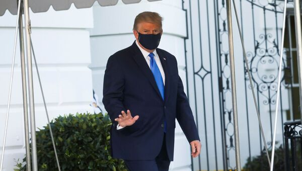 U.S. President Donald Trump waves as he walks out to the Marine One helicopter to fly to Walter Reed National Military Medical Center after testing positive for the coronavirus disease (COVID-19), from the South Lawn at the White House in Washington, U.S., October 2, 2020. - Sputnik International