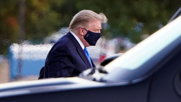 US President Donald Trump arrives at Walter Reed National Military Medical Center by helicopter after the White House announced that he will be working from the presidential offices at Walter Reed for the next few days after testing positive for the coronavirus disease (COVID-19), in Bethesda, Maryland, US, October 2, 2020 - Sputnik International