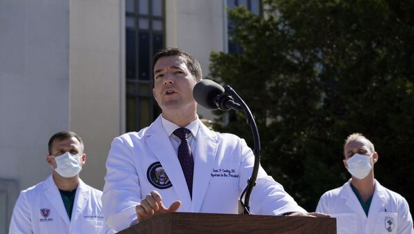 Dr. Sean Conley, physician to President Donald Trump, briefs reporters at Walter Reed National Military Medical Center in Bethesda, Md., Saturday, Oct. 3, 2020. Trump was admitted to the hospital after contracting the coronavirus. (AP Photo/Susan Walsh) - Sputnik International