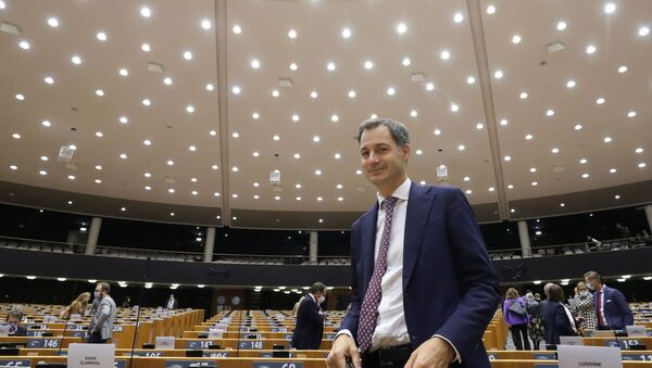 Belgium's new Prime Minister Alexander De Croo is seen at the end of a plenary session of the Belgian Parliament, taking place at the European Parliament to respect the coronavirus disease (COVID-19) safety rules, in Brussels, Belgium October 2, 2020. - Sputnik International