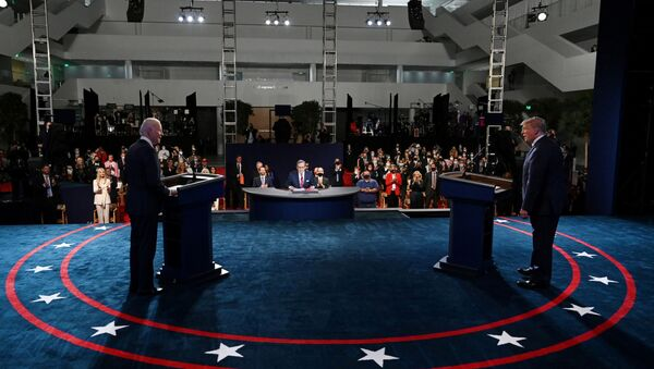 U.S. President Donald Trump and Democratic presidential candidate, former Vice President Joe Biden participate in the first presidential debate at Case Western University and Cleveland Clinic, in Cleveland, Ohio, U.S., September 29, 2020. Picture taken September 29, 2020. Olivier Douliery/Pool via REUTERS - Sputnik International