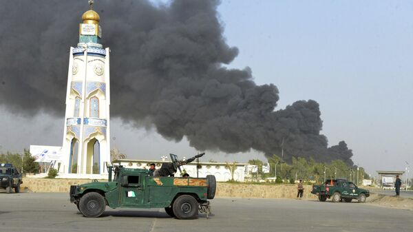 Afghan security forces arrive after a powerful explosion outside the provincial police headquarters in Kandahar province south of Kabul, Afghanistan, Thursday, July 18, 2019. - Sputnik International