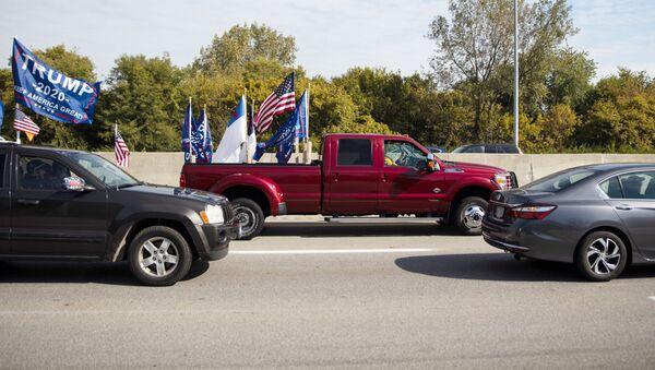 Supporters of U.S. President Donald Trump take part in a car parade in Columbus, Ohio, U.S., October 3, 2020. - Sputnik International