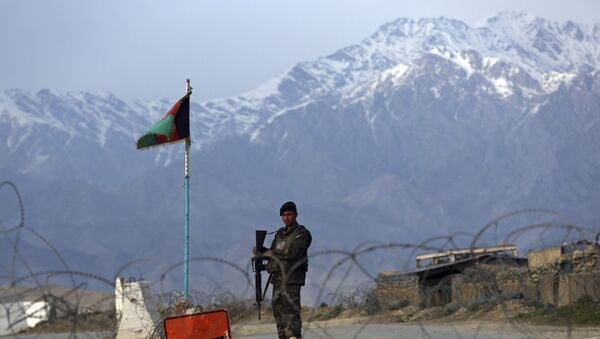 In this Wednesday, April 8, 2020, file photo, an Afghan National Army soldier stands guard at a checkpoint near the Bagram base north of Kabul, Afghanistan. - Sputnik International