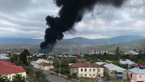 Smoke rises after the recent shelling, in Stepanakert, the self-proclaimed Republic of Nagorno-Karabakh. The situation in Nagorno-Karabakh escalated on September 27, when Yerevan and Baku accused each other of provoking military hostilities. - Sputnik International