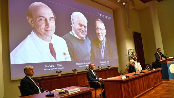 Thomas Perlmann, Secretary of the Nobel Assembly at Karolinska Institutet and of the Nobel Committee for Physiology or Medicine, announces Harvey J? Alter, Michael Houghton and Charles M? Rice as the winners of the 2020 Nobel Prize in Physiology or Medicine during a news conference at the Karolinska Institute in Stockholm, Sweden, October 5, 2020 - Sputnik International