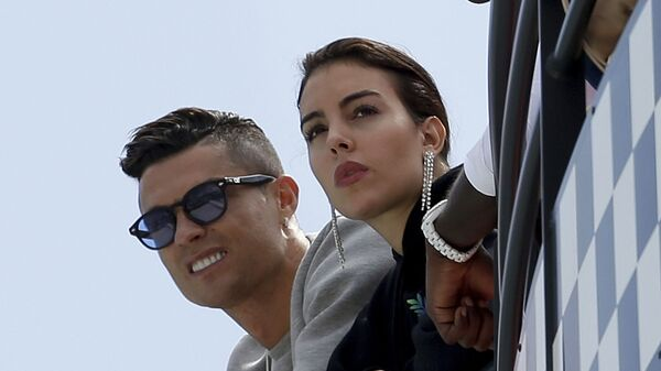 In this May 23, 2019, file photo, Cristiano Ronaldo, left, is flanked by his partner Georgina Rodriguez as they watch the second practice session for a Formula One race at the Monaco racetrack, in Monaco - Sputnik International