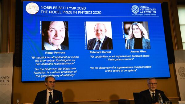David Haviland, member of the Nobel Committee for Physics and Secretary General of the Royal Swedish Academy of Sciences Goran K. Hansson announce the winners of the 2020 Nobel Prize in Physics presented on the screen: Roger Penrose, Reinhard Genzel and Andrea Ghez during a news conference at the Royal Swedish Academy of Sciences, in Stockholm, Sweden October 6, 2020 - Sputnik International