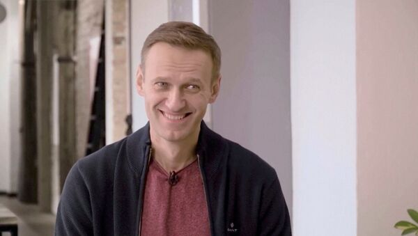 Russian opposition politician Alexei Navalny smiles during an interview with prominent Russian YouTube blogger Yury Dud, in Berlin, Germany, in this still image taken from a handout video released October 6, 2020 - Sputnik International