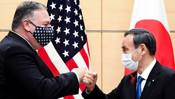 Japan's Prime Minister Yoshihide Suga and U.S. Secretary of State Mike Pompeo greet prior to their meeting at the prime minister's office in Tokyo, Japan October 6, 2020 - Sputnik International