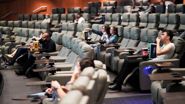 People take their seats inside the Odeon Luxe Leicester Square cinema, on the opening day of the film Tenet, amid the coronavirus disease (COVID-19) outbreak, in London, Britain, August 26, 2020 - Sputnik International
