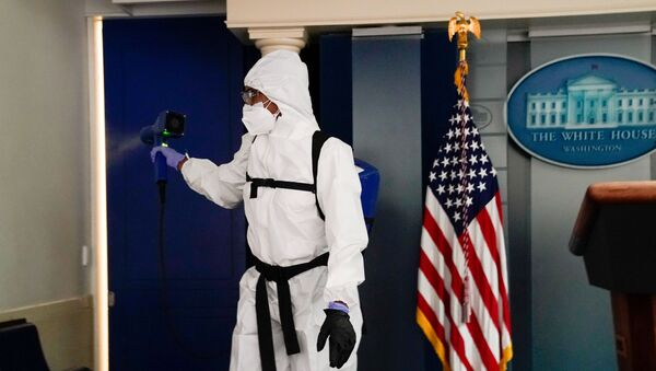 A member of the White House cleaning staff sprays the press briefing room the evening of U.S. President Donald Trump's return from Walter Reed Medical Center after contracting the coronavirus disease (COVID-19), in Washington, U.S., October 5, 2020. - Sputnik International