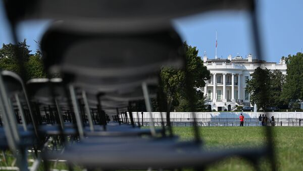 Empty chairs representing a fraction of the 200,000 U.S. lives lost to coronavirus disease (COVID-19) are seen during the National COVID-19 Remembrance near the White House in Washington, U.S. October 4, 2020. - Sputnik International