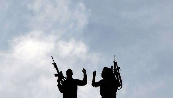 Palestinian Islamic Jihad militants hold up their guns during a rally to mark the 25th anniversary of the movement's foundation in Gaza City, on October 4, 2012.  - Sputnik International