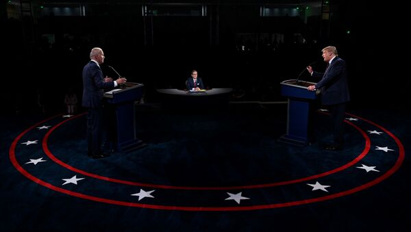 US President Donald Trump and Democratic presidential candidate, former Vice President Joe Biden participate in the first presidential debate at Case Western University and Cleveland Clinic, in Cleveland, Ohio, US, September 29, 2020 - Sputnik International