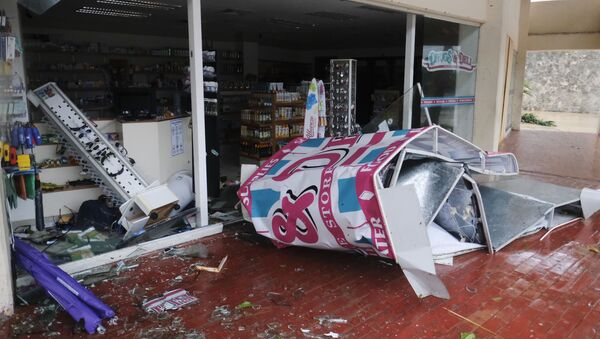 A storefront stands shattered by Hurricane Delta in Cancun, Mexico, Wednesday, Oct. 7, 2020. Hurricane Delta made landfall Wednesday just south of the Mexican resort of Cancun as a Category 2 storm, downing trees and knocking out power to some resorts along the northeastern coast of the Yucatan Peninsula. - Sputnik International