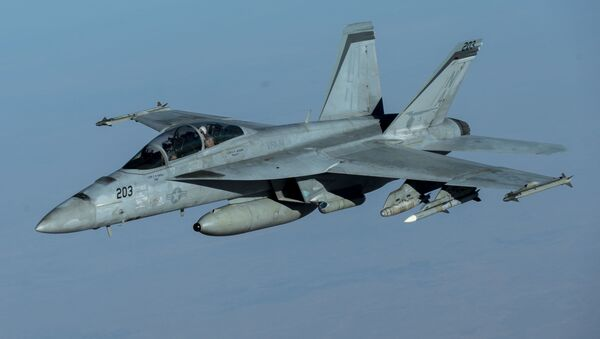 A U.S. Navy F/A-18F Super Hornet, from the Mighty Shrikes of Strike Fighter Squadron (VFA) 94, flies over the US Central Command area of responsibility during a mission in support of Operation Inherent Resolve, 30 September 2020.  - Sputnik International