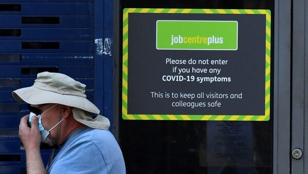 A person wearing a protective face mask walks past a Job Centre Plus office, amidst the outbreak of the coronavirus disease (COVID-19) in London, Britain, August 11, 2020. - Sputnik International