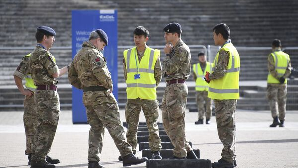 British Army soldiers get instructions outside the ExCel center which is being turned in to a 4000 bed temporary hospital for coronavirus patients in London, Tuesday, March 31, 2020. - Sputnik International