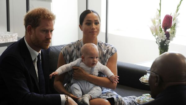 Britain's Prince Harry and Meghan, Duchess of Sussex, holding their son Archie, meet with Anglican Archbishop Emeritus, Desmond Tutu in Cape Town, South Africa, Wednesday Sept. 25, 2019. - Sputnik International