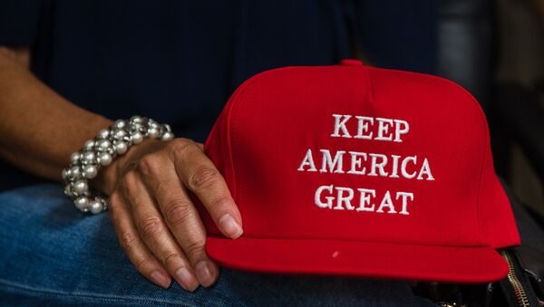 Deborah Palomba holds a Keep America Great hat as she watches US President Donald Trump acceptance speech for the Republican Party nomination for reelection during the final day of the Republican National Convention on TV in the office of San Diego County's Republican Party in Rancho Bernardo, California on August 27, 2020 - Sputnik International