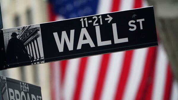 A Wall Street sign is pictured outside the New York Stock Exchange in the Manhattan borough of New York City, New York, U.S., October 2, 2020.  - Sputnik International