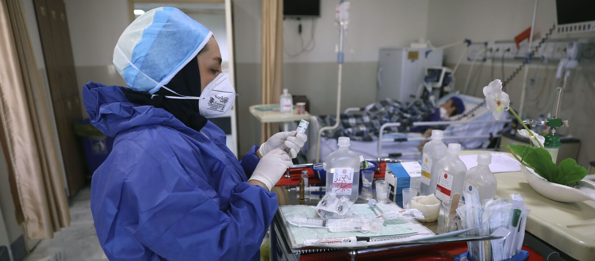 In this Tuesday, June 16, 2020, photo, a nurse prepares medicines for COVID-19 patients at the Shohadaye Tajrish Hospital in Tehran, Iran. After months of fighting the coronavirus, Iran only just saw its highest single-day spike in reported cases after Eid al-Fitr, the holiday that celebrates the end of Ramadan.  - Sputnik International, 1920