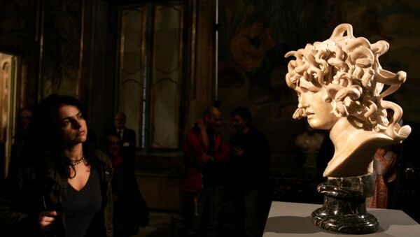 A visitor looks at a marble bust, Bust of Medusa, made by Italian sculptor Gian Lorenzo Bernini between 1644 and 1648, during its inauguration at Rome's Capitolini Museum after its restoration, Wednesday, Nov. 22, 2006. The bust, Bernini's depiction of the Greek mythological character Medusa, is considered one of the most original interpretations of the female myth whose gaze could turn people to stone. - Sputnik International