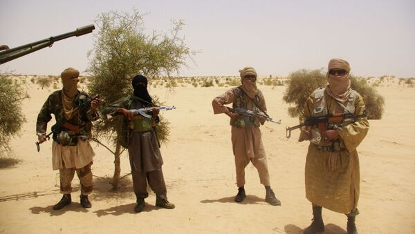 In this Tuesday, April 24, 2012 file photo, fighters from Islamist group Ansar Dine stand guard during a hostage handover, in the desert outside Timbuktu, Mali.   - Sputnik International