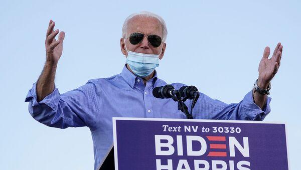 Democratic U.S. presidential nominee Joe Biden speaks during a drive-in campaign event at the Southeast Career Technical Academy in Las Vegas, Nevada, U.S., October 9, 2020. - Sputnik International