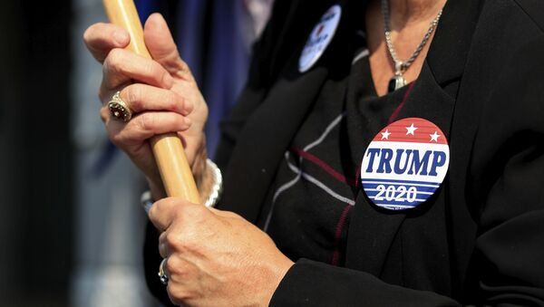 A view of a Trump button worn by a supporter, at the Hamilton County Board of Elections as people arrive to participate in early voting, Tuesday, Oct. 6, 2020, in Norwood, Ohio - Sputnik International