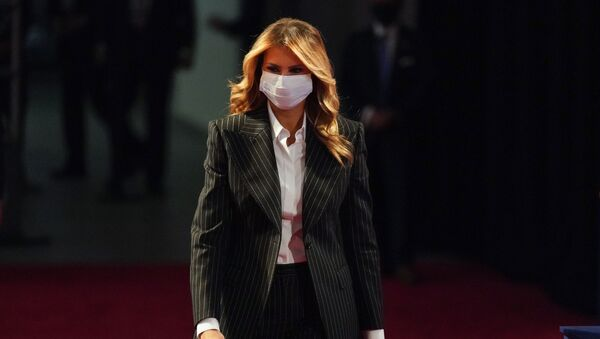 In this Sept. 29, 2020, file photo, first lady Melania Trump, wearing a facemask, walks towards her seat for the during the first presidential debate Tuesday, Sept. 29, 2020, at Case Western University and Cleveland Clinic, in Cleveland, Ohio - Sputnik International