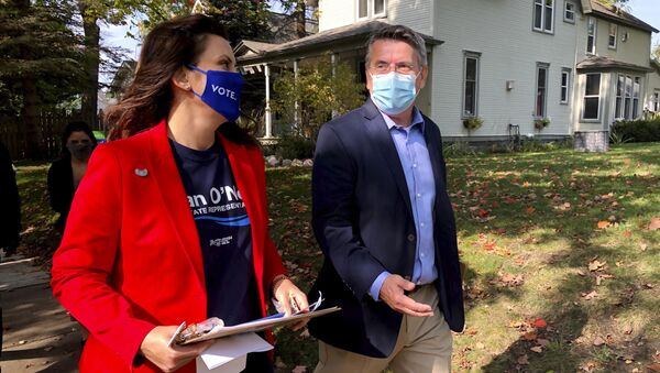Michigan Gov. Gretchen Whitmer campaigns with Dan O'Neil, a Democratic candidate for the Michigan House in Traverse City, Mich., Friday, Oct. 9, 2020. Whitmer visited the area the day after police announced a foiled plot to kidnap the governor.  - Sputnik International