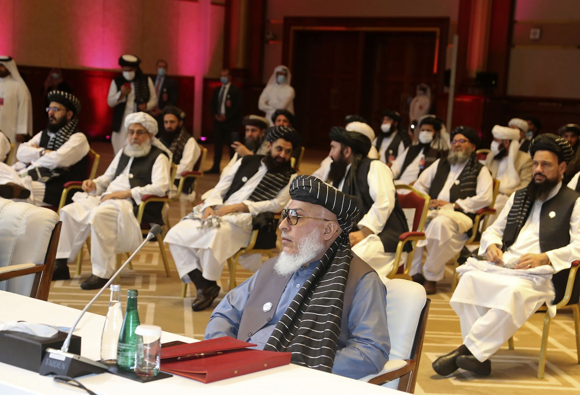 In this Sept. 12, 2020, file photo, Taliban negotiator Abbas Stanikzai, center front, and his delegation attend the opening session of peace talks between the Afghan government and the Taliban, in Doha, Qatar. Afghanistan's Taliban on Thursday, Oct. 8, 2020, welcomed a tweet from President Donald Trump in which he promised to have the last of the U.S.'s troops out of Afghanistan by Christmas. If that withdrawal happens, it would be months ahead of schedule and the tweet made no reference to a Taliban promise to fight terrorist groups — a previous pre-requisite for an American withdrawal. - Sputnik International, 1920, 07.09.2021