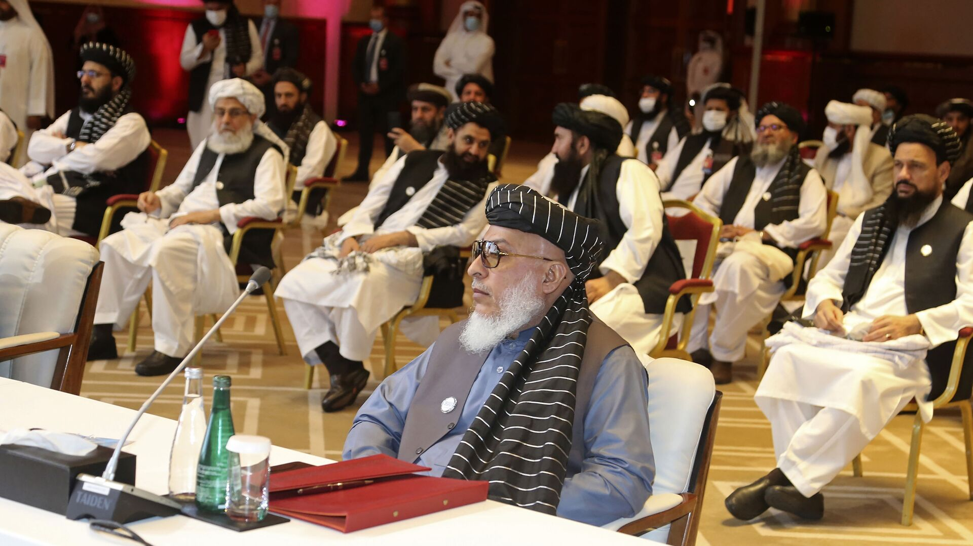 In this Sept. 12, 2020, file photo, Taliban negotiator Abbas Stanikzai, center front, and his delegation attend the opening session of peace talks between the Afghan government and the Taliban, in Doha, Qatar. Afghanistan's Taliban on Thursday, Oct. 8, 2020, welcomed a tweet from President Donald Trump in which he promised to have the last of the U.S.'s troops out of Afghanistan by Christmas. If that withdrawal happens, it would be months ahead of schedule and the tweet made no reference to a Taliban promise to fight terrorist groups — a previous pre-requisite for an American withdrawal. - Sputnik International, 1920, 20.08.2021