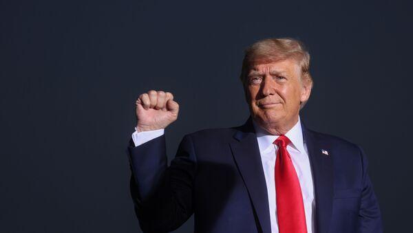 U.S. President Donald Trump pumps his fist during a campaign rally in Reno, Nevada, U.S., September 12, 2020 - Sputnik International