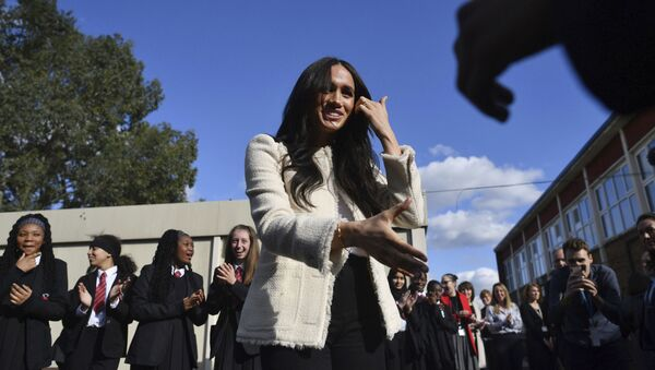 Britain's Meghan, Duchess of Sussex, is greeted by pupils at the Robert Clack Upper School in Dagenham, Essex, in eastern London, during a surprise visit to celebrate International Women's Day, Friday, March 6, 2020 - Sputnik International
