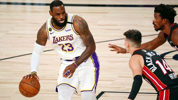 Oct 11, 2020; Lake Buena Vista, Florida, USA; Los Angeles Lakers forward LeBron James (23) dribbles while defended by Miami Heat guard Tyler Herro (14) during the first quarter in game six of the 2020 NBA Finals at AdventHealth Arena.  - Sputnik International