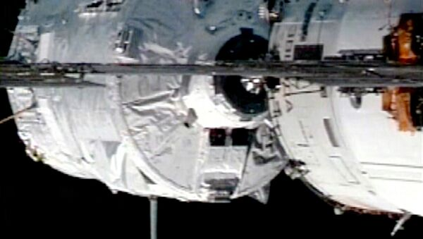In this image from NASA Television, the Jules Verne Automated Transfer Vehicle approaches the on the International Space Station's Zvezda Service Module for docking, Thursday, April 3, 2008. - Sputnik International