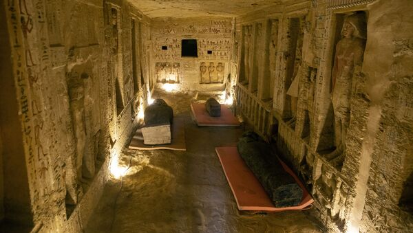 Several sarcophagi are displayed inside a tomb at the Saqqara archaeological site, 30 kilometers (19 miles) south of Cairo, Egypt, on Saturday, Oct. 3, 2020 - Sputnik International